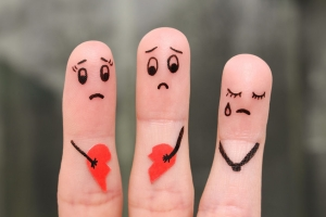 56859284 - finger art of family during quarrel. the concept of parents quarrel, child was upset.